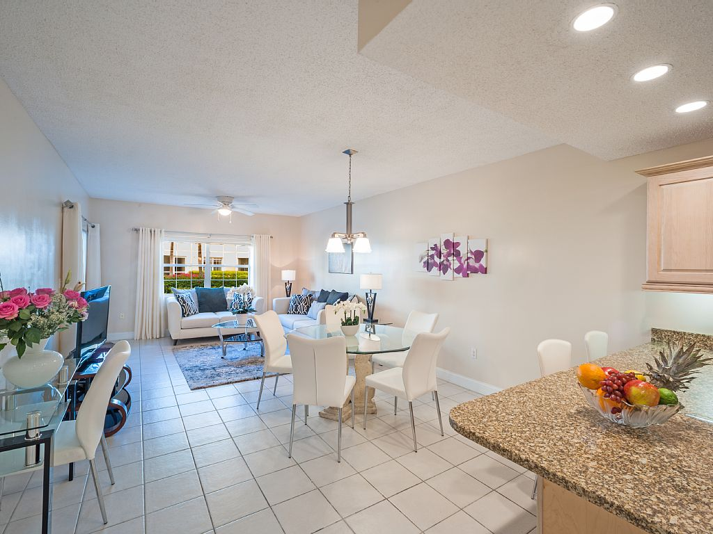 Open floor plan with living area, dining area and kitchen.