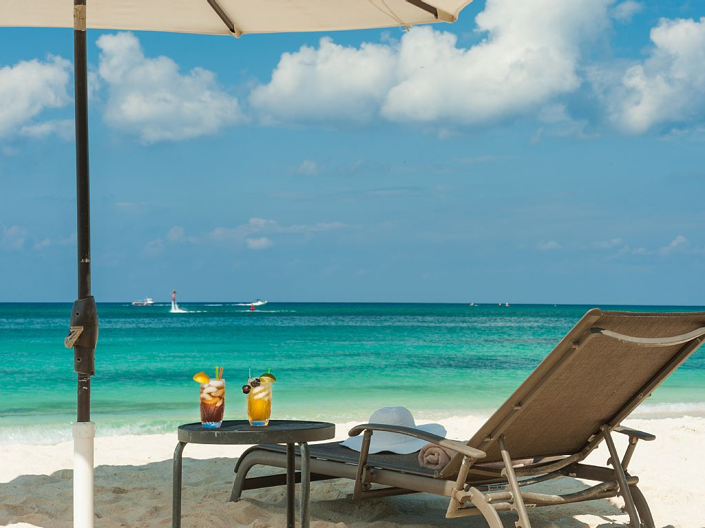 Relax on the Powder White Sands at Regal Beach Club.