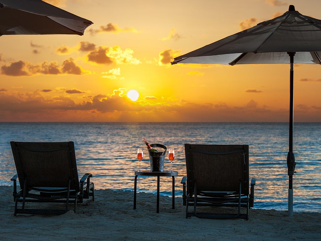 Take in the Sunset on the Beach.