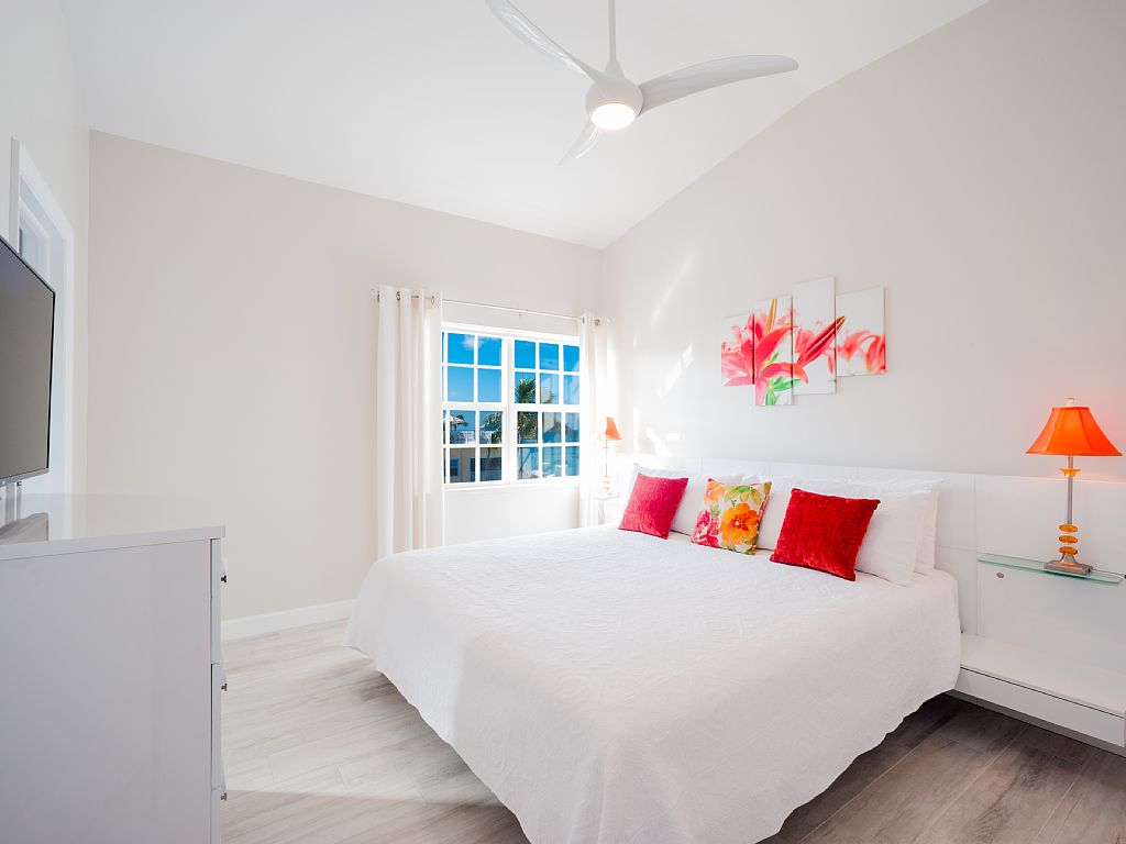 Bright and fresh master bedroom with ensuite bath