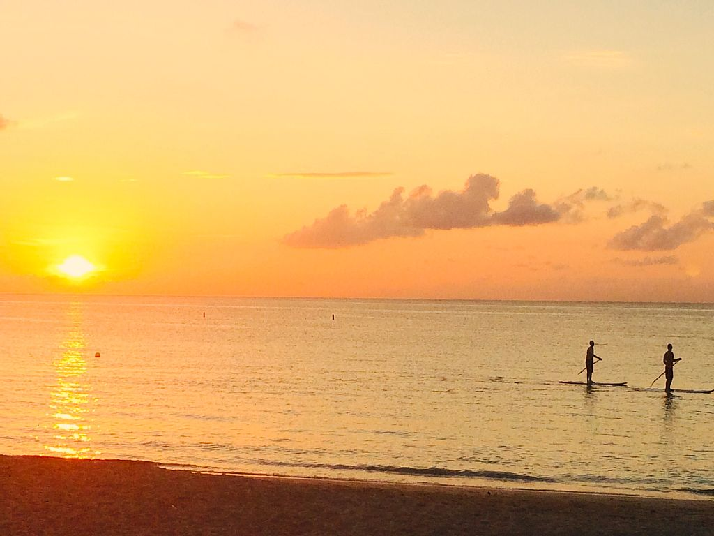 Go paddle boarding at dusk.