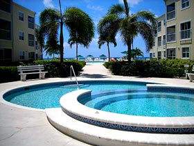 Directly on 7 Mile Beach, get Cayman Comfort and Serenity relaxing in this beautiful 2 bedroom/2 bath second floor condo. Great view overlooking 2 pools, royal palms and turquoise waters of the Caribbean Sea.