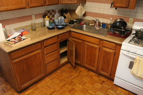 It Seems Like The Only Location That Would Make Any Sense Would Be To The  Left Of The Sink, Replacing The Cabinet Whose Door Is Open, And The Cabinet  To Its ...