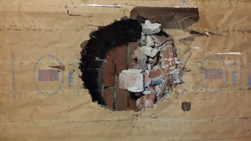 2 Ft Diameter Hole In Cinder Block Wall By Nogeel