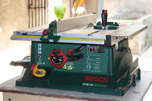 Mounting a vega utility 26 fence to a bosch pts 10 table saw by it has a sliding table to the left of the blade and a slide out out feed table notched to accept the sliding table further there is a slide out support on greentooth