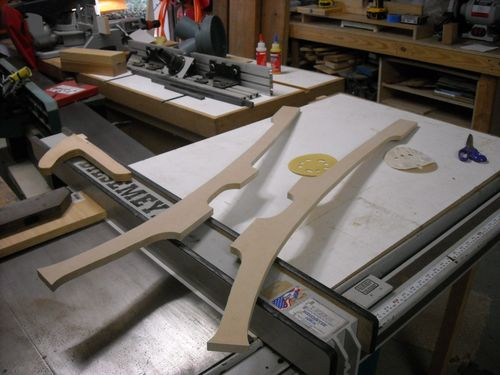 The next photo is a pair of templates to draw out the back legs of the rocking chair. I am using MDF because it is easy to shape and make the eased curves ...