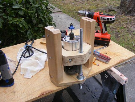 Plans for a bench top router table by brett lumberjocks i saw it here on ljs but i dont remember who posted it there is not much to it and you could hang it under any table and adjust it from the greentooth Image collections
