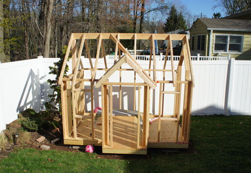 Building my kids 39 playhouse 5 framed the roof by andy for How to make a playhouse out of wood