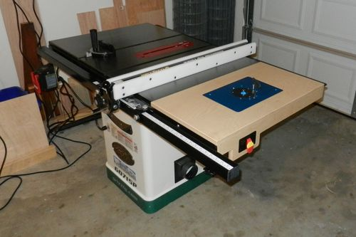Router table and fence by rex b lumberjocks woodworking it is made of 34 baltic birch plywood joined with glue and pocket hole screws it is attached to the table saw by 14 20 bolts through holes i drilled in greentooth Choice Image