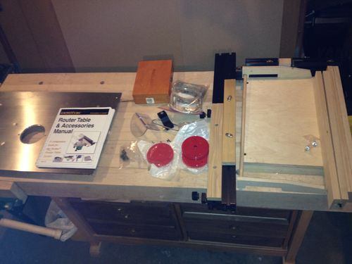 Look what an lj santa sent me by sandra lumberjocks not only did she send me a router table top but also a set of router bits router fence and a right angle sled insert plates and all the instructions greentooth Choice Image