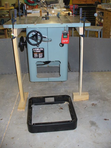 I Built A Base To Raise My Unisaw And To Incorporate The Dust Collection. I  Raise All My Tools The Last One Being My Brand New Grizzly Band Saw