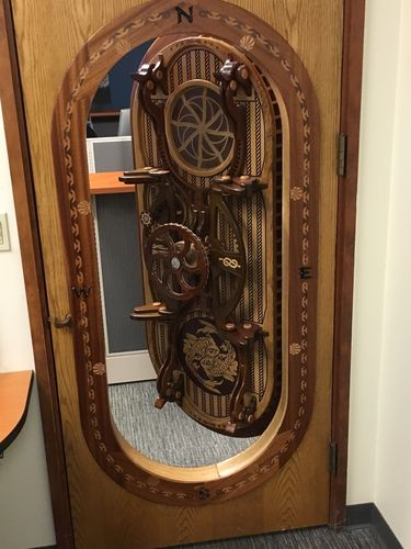 This is a submarine door all made from recycled lumber. It is grafted into a standard door which is the door to my office at work. & John Hansen @ LumberJocks.com ~ woodworking community