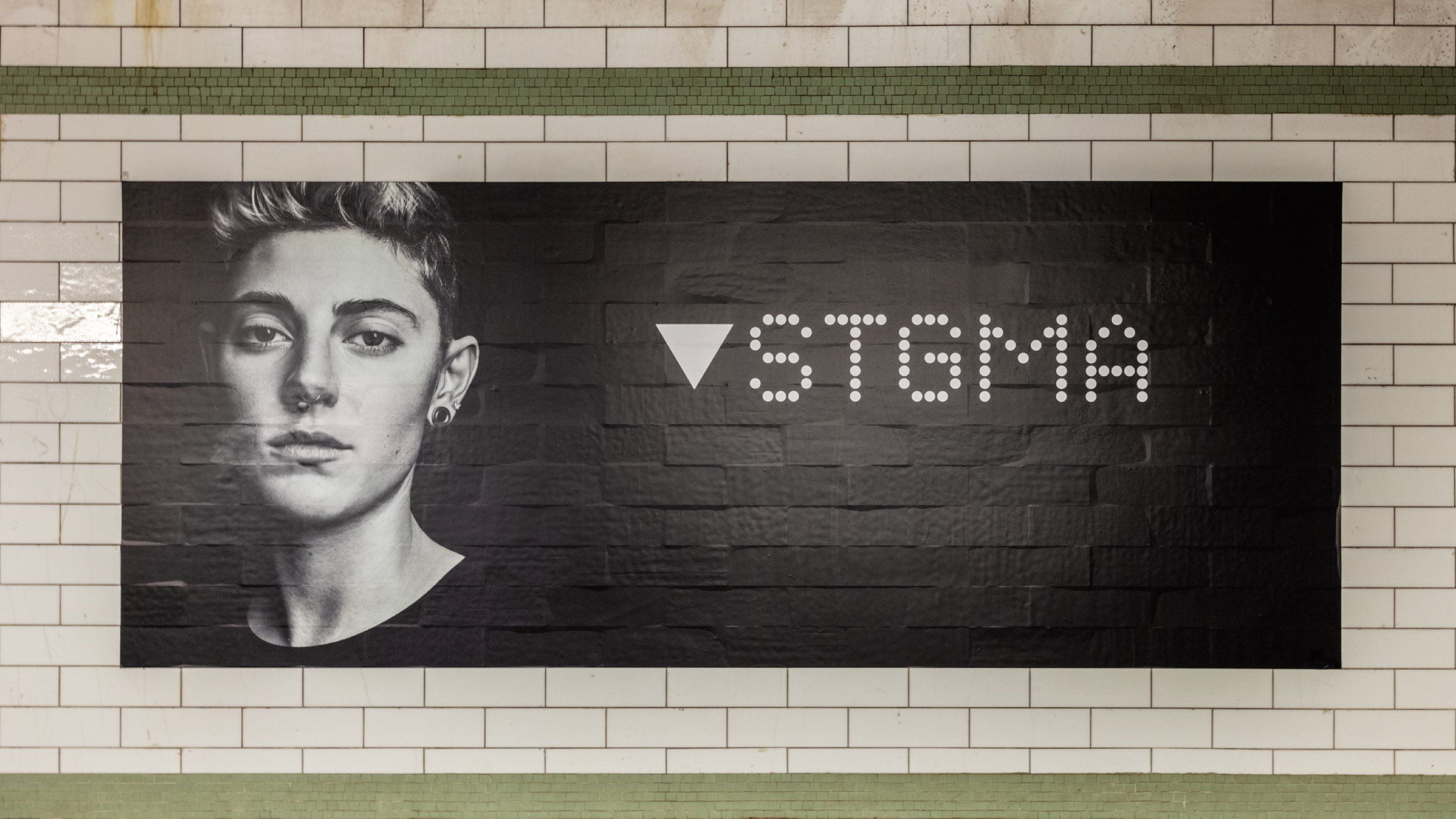 STGMA/Stigma subway poster for Impact Shares' WOMN campaign
