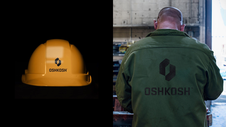 Oshkosh logo on a hard hat and jacket