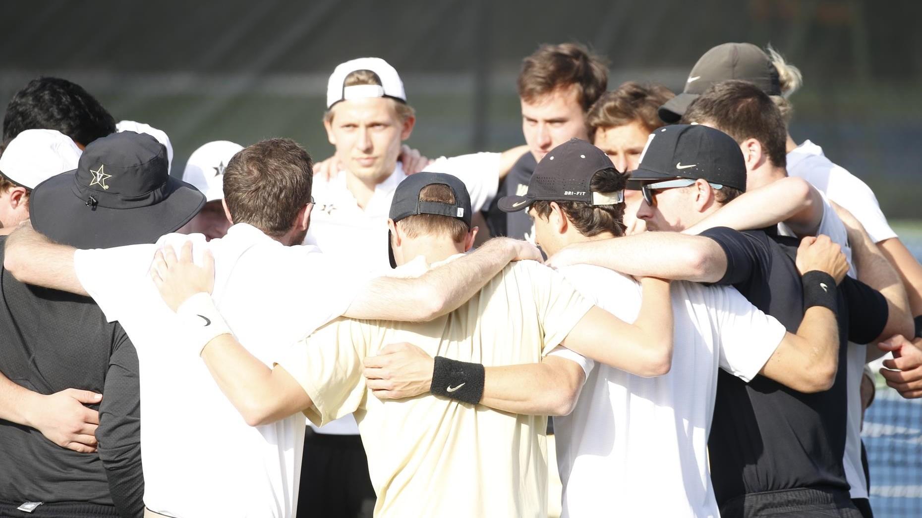 M. tennis huddle