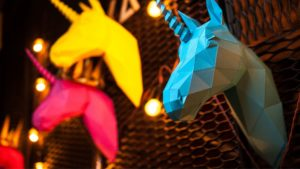 colorful paper unicorn busts serve as a symbolic representation of B2B video marketing myths