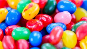 a variety of colorful jelly beans serve as a metaphor for different types of video