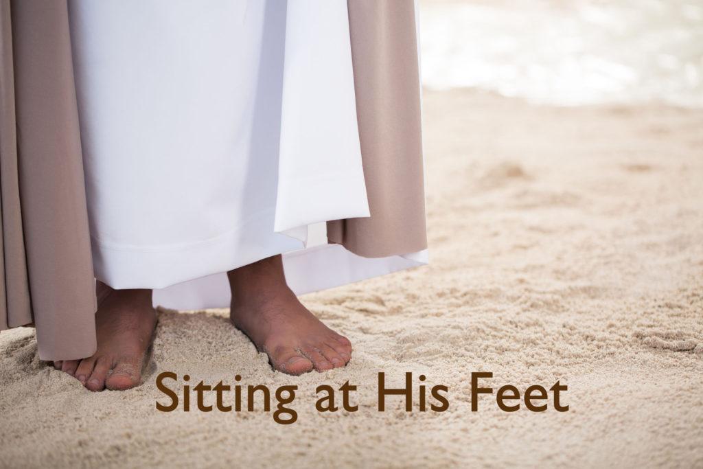 Feet of Jesus Christ standing on sand