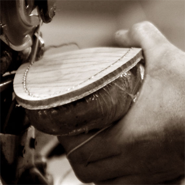A boot being hand stitched