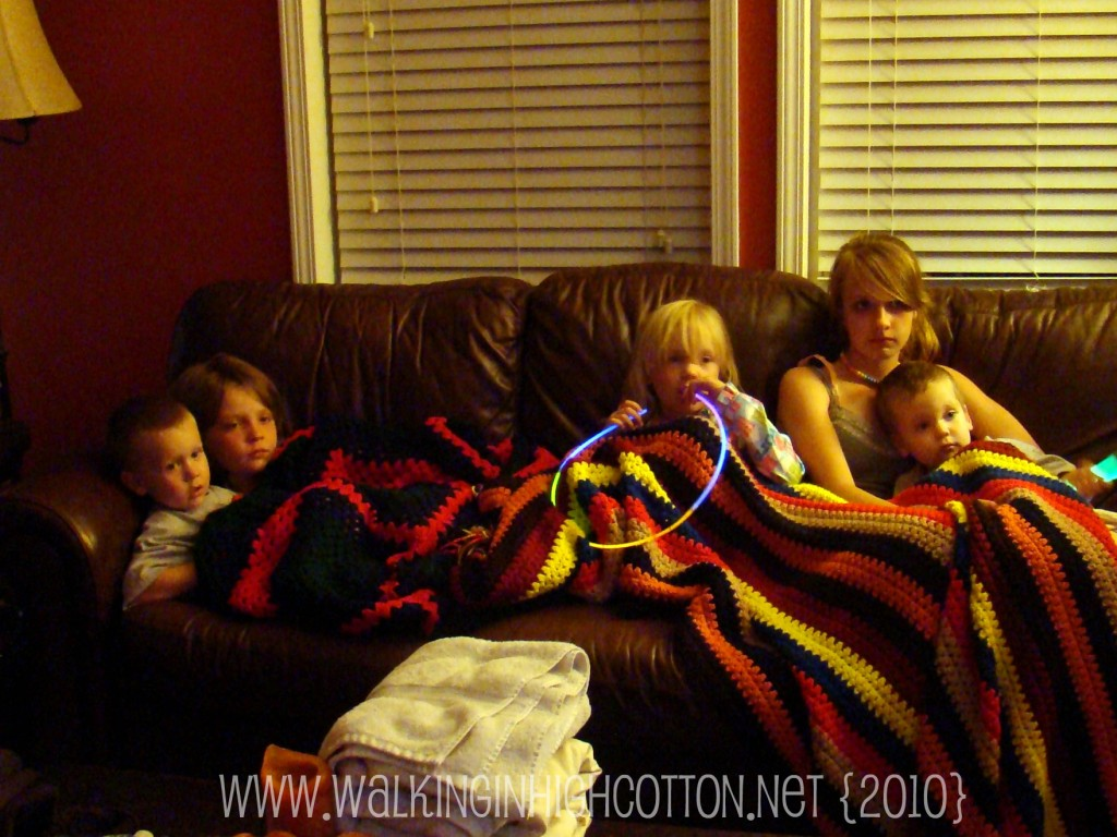 Piling on the couch for a movie every evening quickly became a tradition. July 2010.
