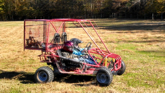 """Mr. Fix-It strapped the duck transport cage to the kiddos go-cart so the Ladybug and the Cowboy could drive out to the field to pick them up and bring them to the """"processing"""" area in front of the garage."""