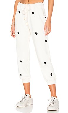 The Cropped Sweatpant in Washed White With Black Hearts