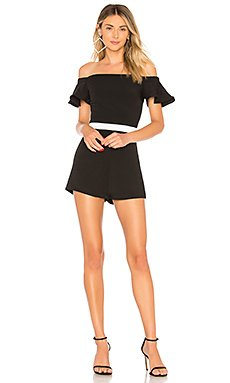 Lulu Ruffle Off Shoulder Romper                                             About Us