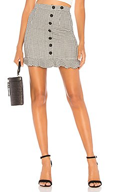 Loren Button Mini Skirt                                             About Us