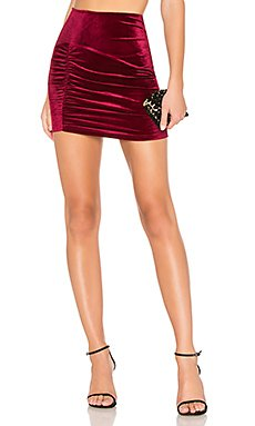 Ellie Ruched Mini Skirt                                             About Us