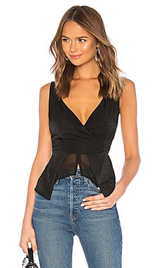 Mikaela Peplum Top                                             About Us