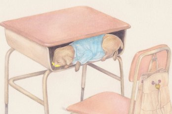 Dog hiding in a desk, with yellow stuff on his mouth