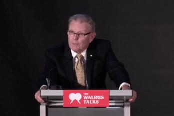 Man speaking at a Walrus Talks