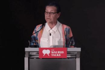 Woman speaking at a Walrus Talks