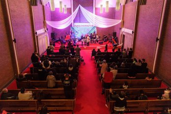 people stand inside a church in winnipeg