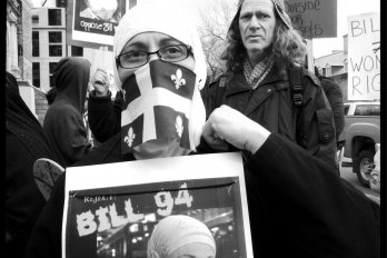 Protesters rallying against bill Bill 94 in Quebec