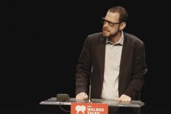 Man Speaking at Walrus Talks event