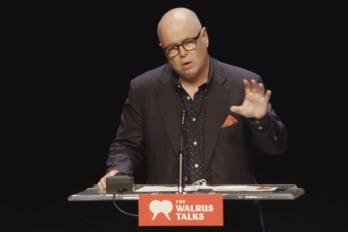 Man speaking at Walrus Talks