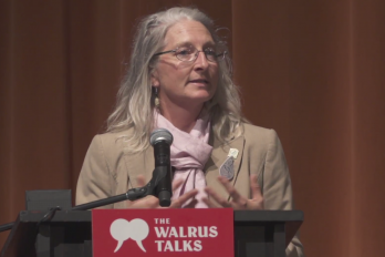 Woman performing for crowd at The Walrus Talks