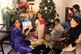 Family opening up presents at Christas