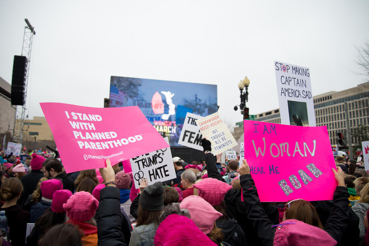 Photography of Protesters Holding Signs at the Women's March