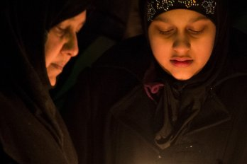 Photograph of a candlelight vigil held at the Alberta Legislature in Edmonton on Monday evening, January 30, 2017 for the people who were killed and wounded in the shooting at a Québec City mosque.
