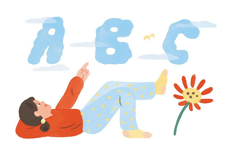 A girl lays on her back pointing up at clouds in the shapes of letters.
