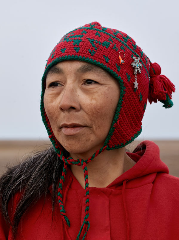 Woman in a red toque.