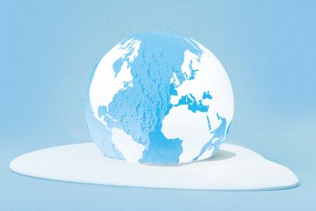 A globe sitting in a white puddle.