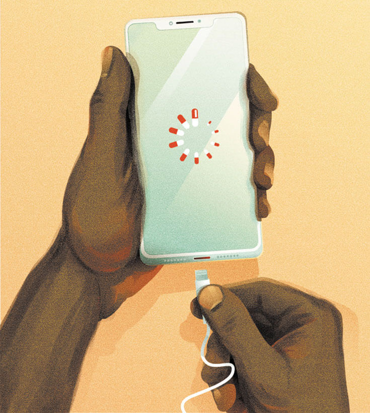 A pair of hands plugs a cable into an iPhone. The phone's loading screen displays a circle of pill capsules.