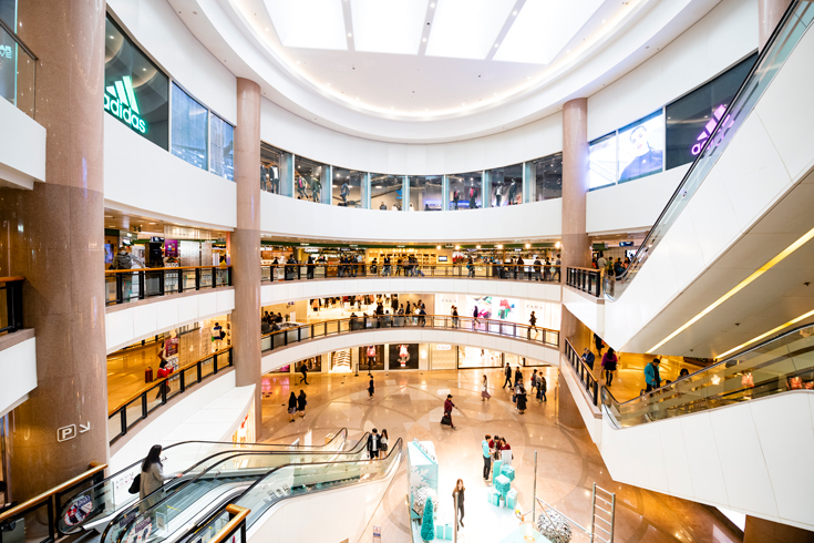 An interior shot of Harbour City, a mall in Hong Kong, sparsely populated with shoppers.