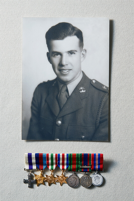 Portrait of Harry Ward Macdonald with medals.