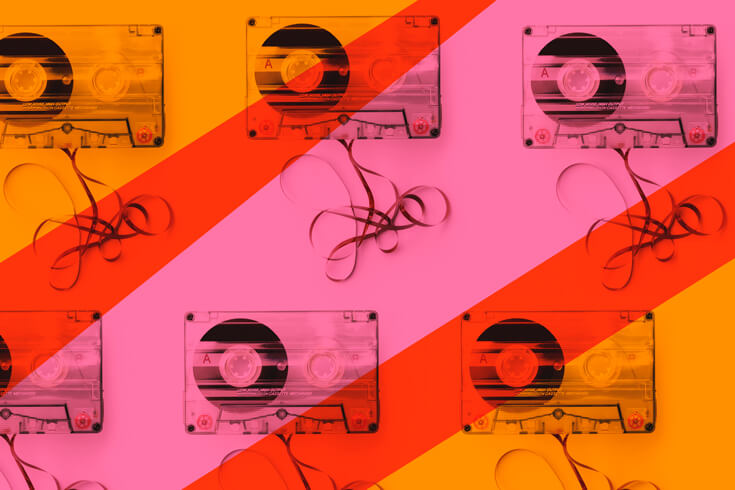 Six cassettes with unspooling tape coloured in pink, red and orange