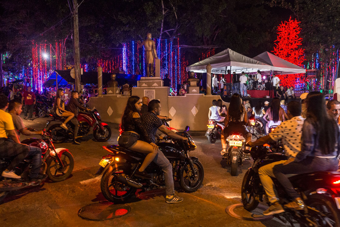 Young people on motorbikes cruise the streets on a Friday night.
