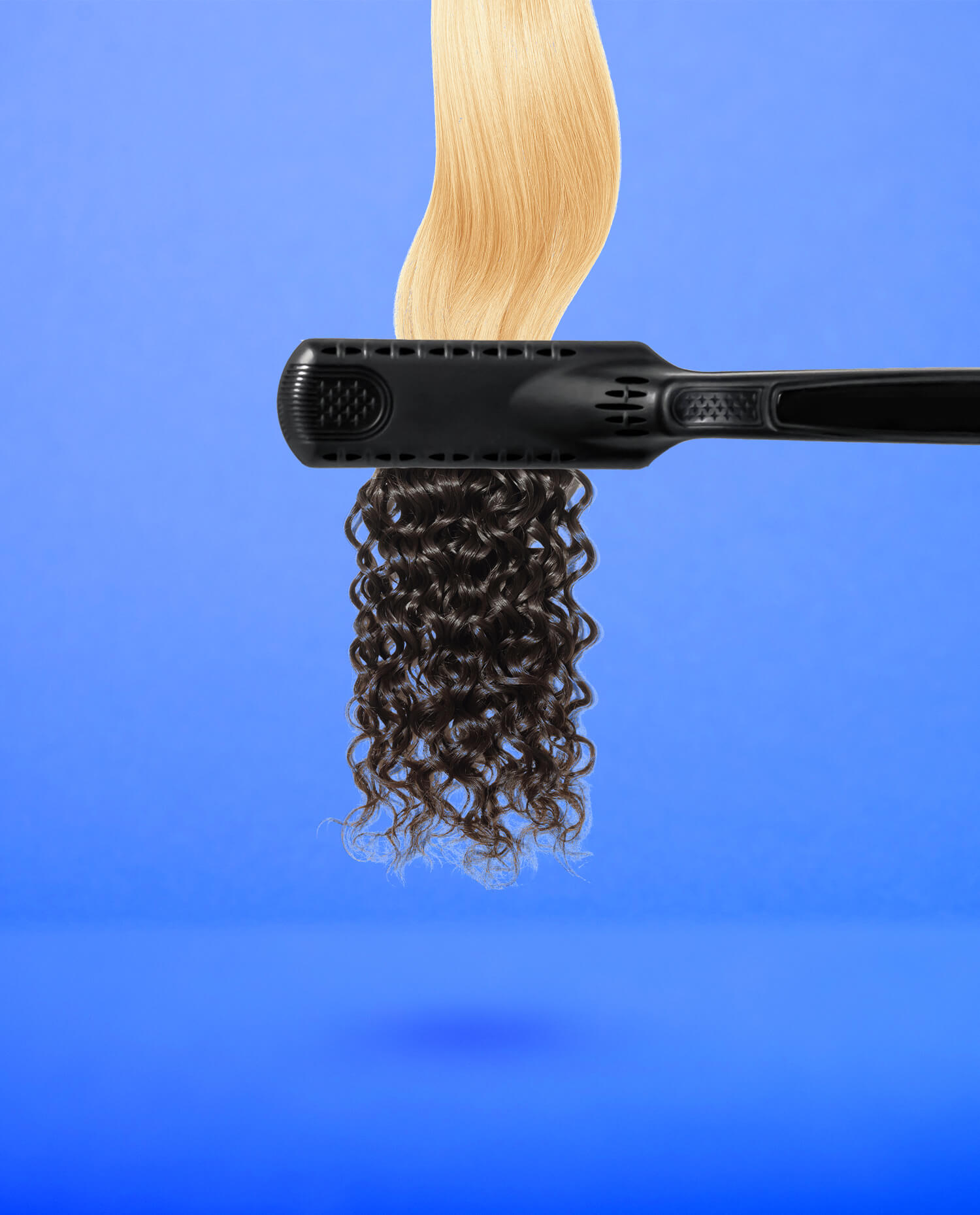 a83169eeb89 Curling iron with blonde hair on one side and curly black hair on the other